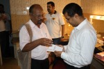 Sivakumar showing his yet-to-be-published book to Chetan